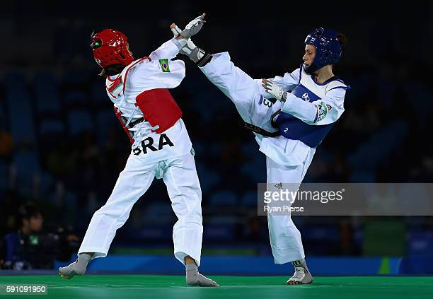 Andrea Kilday of New Zealand had her kick blocked by Iris Sing of Brazil during the Taekwondo Women's 49kg Round One contest at Cairoca Arena 3 on...