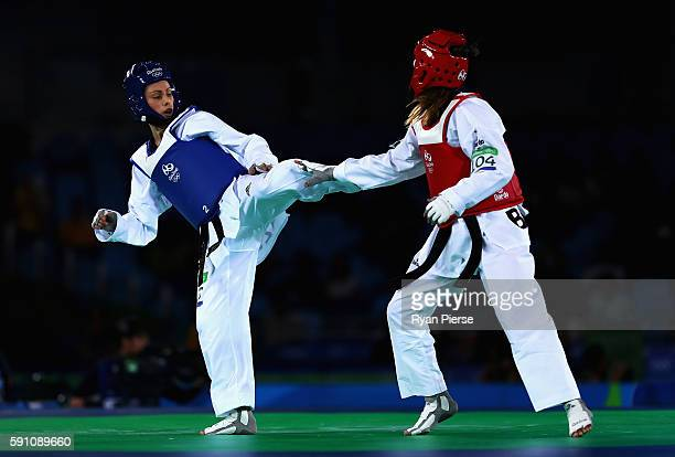 Andrea Kilday of New Zealand kicks Iris Sing of Brazil during the Taekwondo Women's 49kg Round One contest at Cairoca Arena 3 on August 18 2016 in...