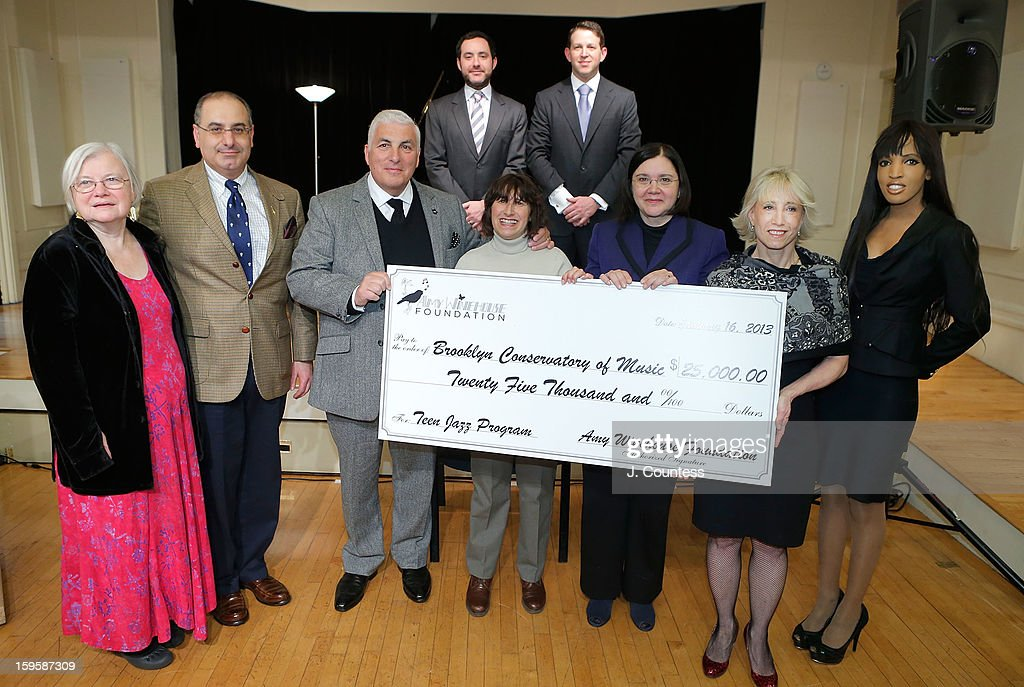 Andrea Knutson, Jacob Yahiayan, Mitch Winehouse, Janis Winehouse, Brooklyn Conservatory of Music Executive Director Karen Geer, Director of the Amy Winehouse Foundation Julie Muraco, Elena Ayot, (back row L-R) Joel Kress and Jason Tepper attend a grant award presentation by the The Amy Winehouse Foundation at the Brooklyn Conservatory of Music on January 16, 2013 in New York City.