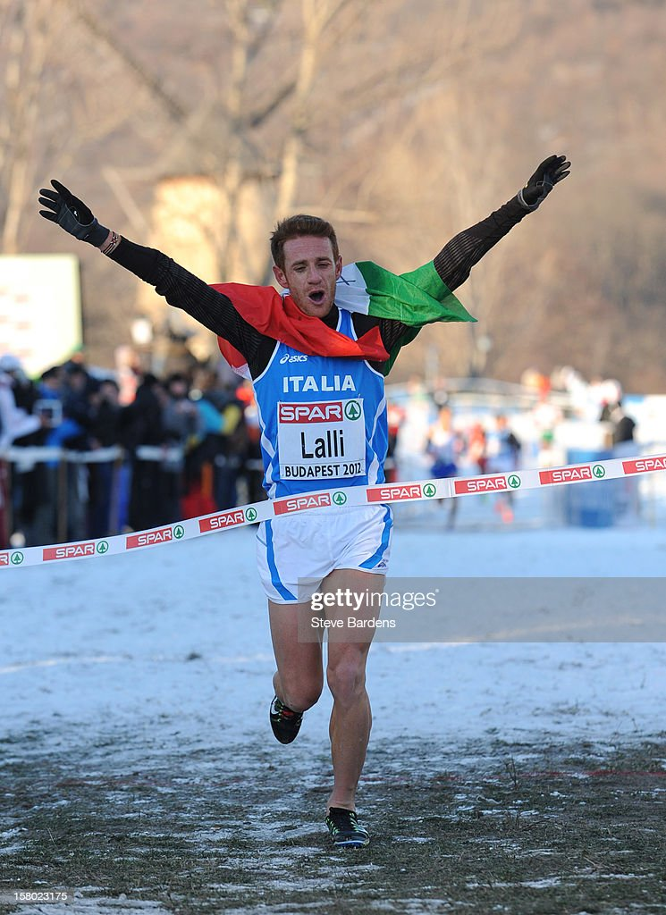 Andrea Lalli of Italy celebrates as he crosses the finish line to win the Senior Men's race during the 19th SPAR European Cross Country Championships on December 9, 2012 in Budapest, Hungary.
