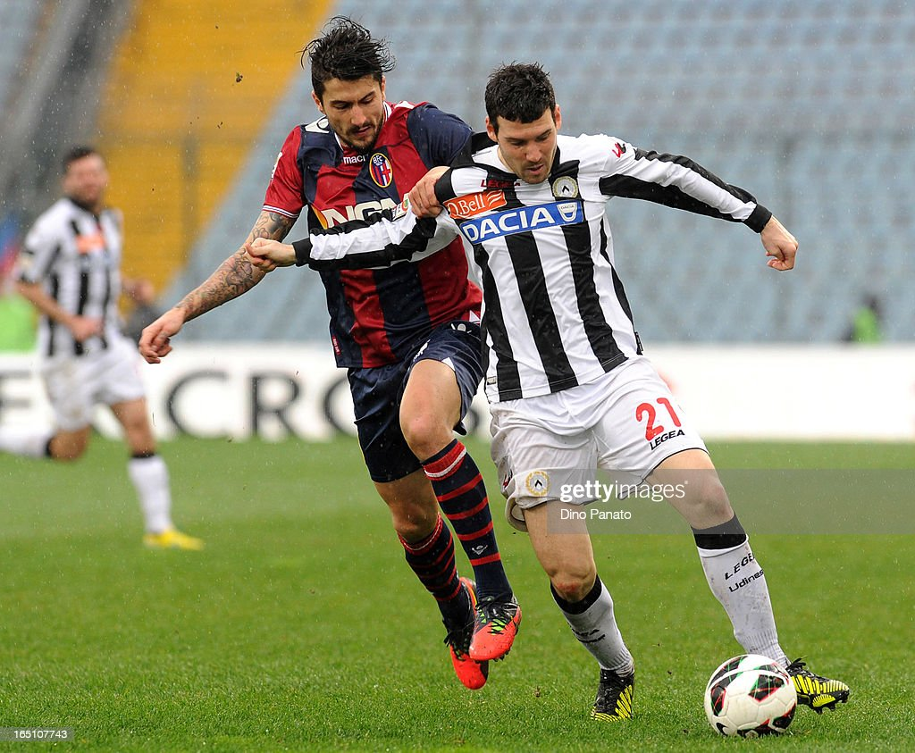 Andrea Lazzari (R) of Udinese Calcio competes with Panagiotis Kone of Bologna FC during the Serie A match between Udinese Calcio and Bologna FC at Stadio Friuli on March 30, 2013 in Udine, Italy.