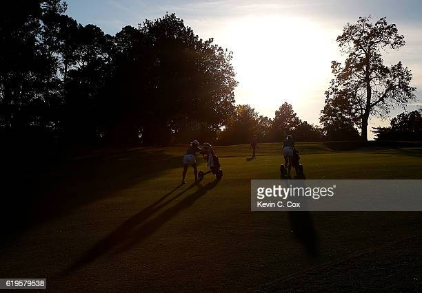 Andrea Lee and teammate Casey Danielson of Stanford walk the fifth playoff hole up the 10th fairway during day 1 of the 2016 East Lake Cup at East...