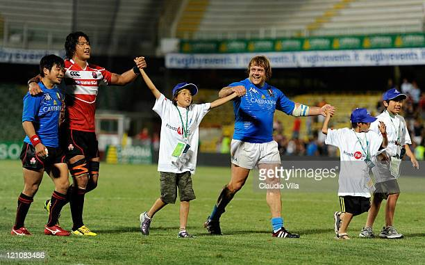 Andrea Lo Cicero of Italy with children fukushima during the friendly match between Italy and Japan at Dino Manuzzi Stadium on August 13 2011 in...