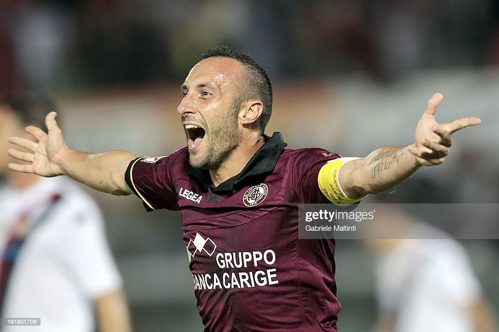 Andrea Luci of AS Livorno Calcio celebrates after scoring a goal during the Serie A match between AS Livorno and Cagliari Calcio at Stadio Armando Picchi on September 25, 2013 in Livorno, Italy.