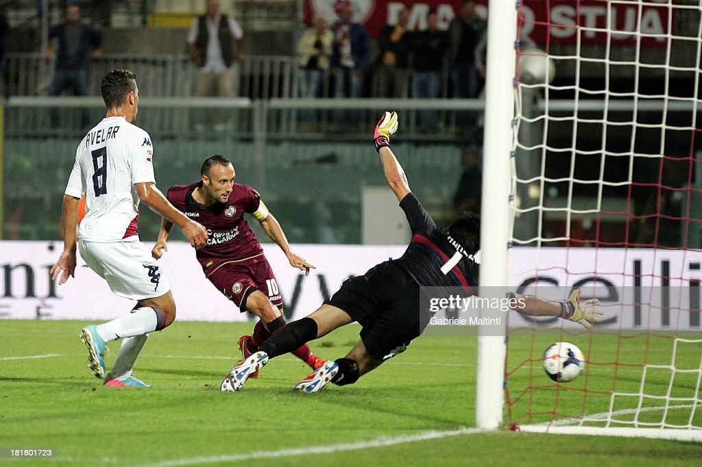 Andrea Luci of AS Livorno scores their first goal during the Serie A match between AS Livorno and Cagliari Calcio at Stadio Armando Picchi on September 25, 2013 in Livorno, Italy.