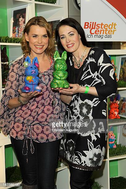 Andrea Luedke and Annika de Buhr attend Easter Bunny Charity Auction at Billstedt Shopping Centre on April 3 2012 in Hamburg Germany