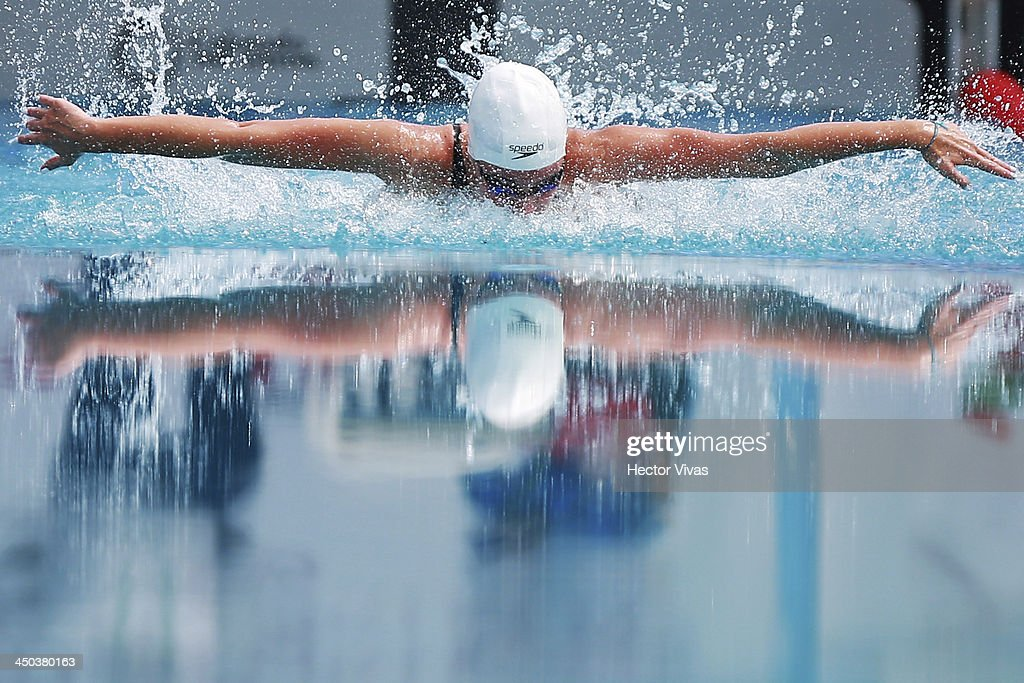 Andrea Malarin of Peru competes during 50 meters butterfly swimming, as part of the XVII Bolivarian Games Trujillo 2013 at pools complex of Mansiche Stadium on November 18, 2013 in Trujillo, Peru.