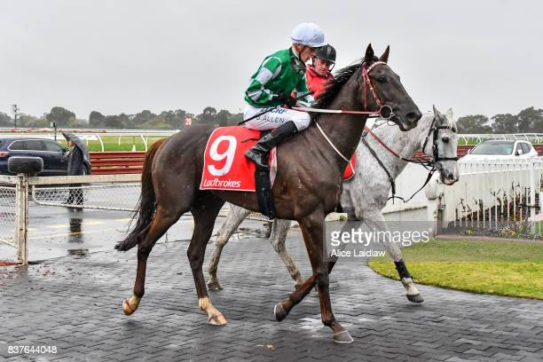Andrea Mantegna ridden by Ben Allen returns to scale after winning the Le Pine Funerals Handicap at Ladbrokes Park Hillside Racecourse on August 23...