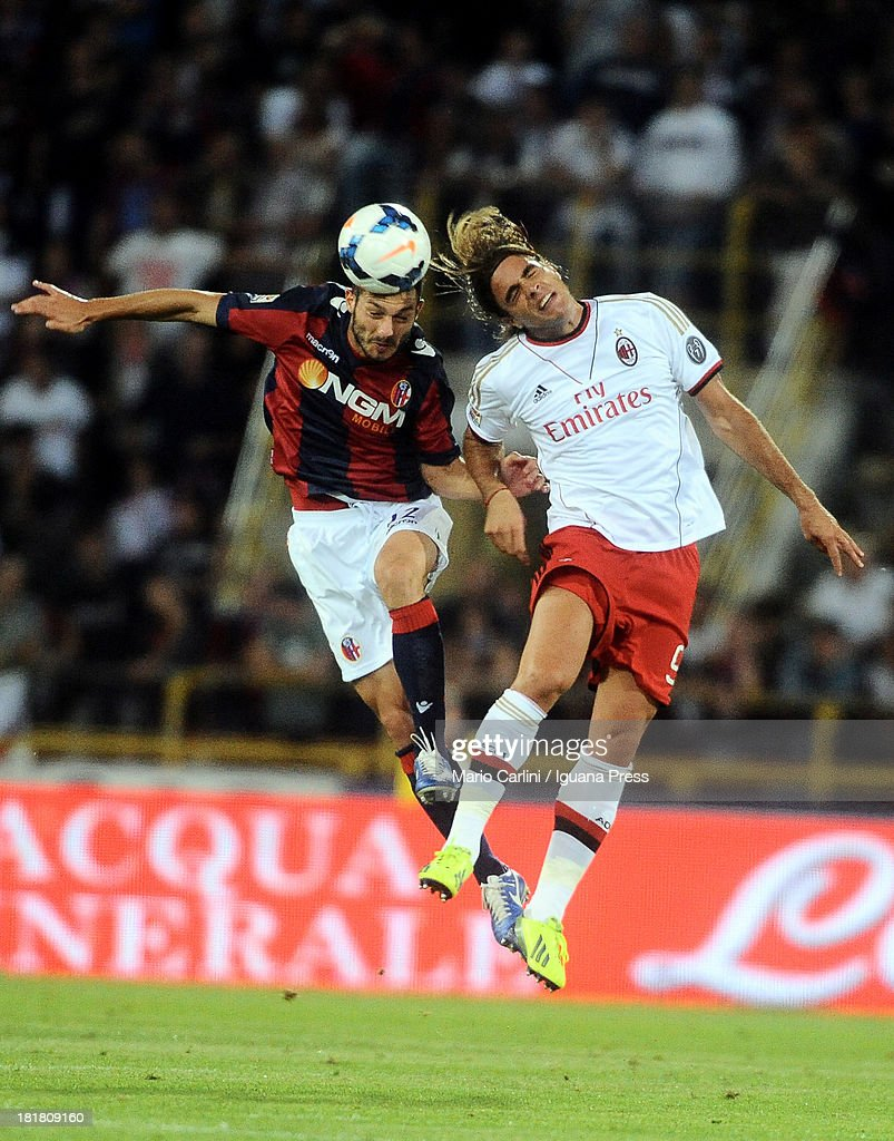 Andrea Mantovani # 22 of Bologna FC ( L ) wins a header with <a gi-track='captionPersonalityLinkClicked' href=/galleries/search?phrase=Alessandro+Matri&family=editorial&specificpeople=4501520 ng-click='$event.stopPropagation()'>Alessandro Matri</a> # 9 of AC Milan ( R ) during the Serie A match between Bologna and AC Milan at Stadio Renato Dall'Ara on September 25, 2013 in Bologna, Italy.