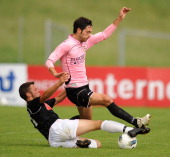 Andrea Mantovani of Palermo and Michael Tcholl of Selezione Alto Adige compete for the ball during a preseason friendly match between US Citta di...