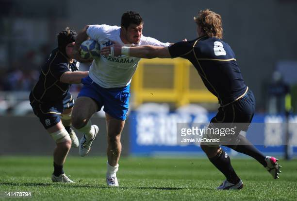 Andrea Masi of Italy is tackled by David Denton of Scotland during the RBS Six Nations match between Italy and Scotland at Stadio Olimpico on March...