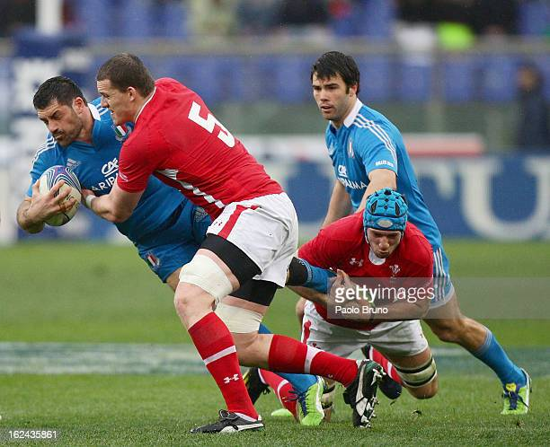 Andrea Masi of Italy is tackled by Ian Evans of Wales during the RBS Six Nations match between Italy and Wales at Stadio Olimpico on February 23 2013...