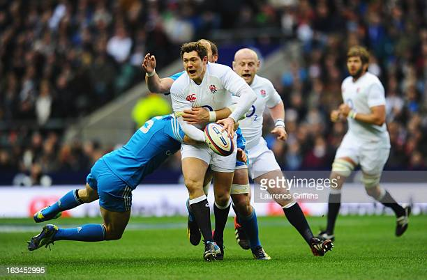 Andrea Masi of Italy tackles Alex Goode of England during the RBS Six Nations match England and Italy at Twickenham Stadium on March 10 2013 in...