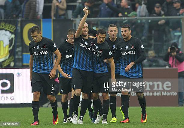 Andrea Masiello of Atalanta BC celebrates with his teammates after scoring the opening goal during the Serie A match between Atalanta BC and FC...