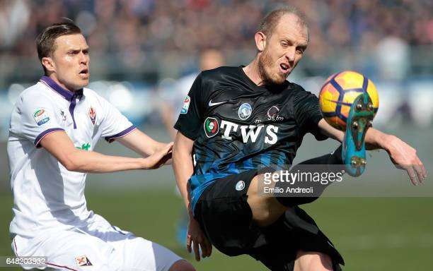 Andrea Masiello of Atalanta BC competes for the ball with Josip Ilicic of ACF Fiorentina during the Serie A match between Atalanta BC and ACF...
