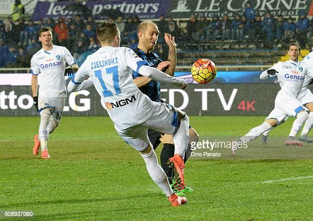 Andrea Masiello of Atalanta BC competes with Piotr Zielinski of Empoli FC during the Serie A match between Atalanta BC and Empoli FC at Stadio Atleti...