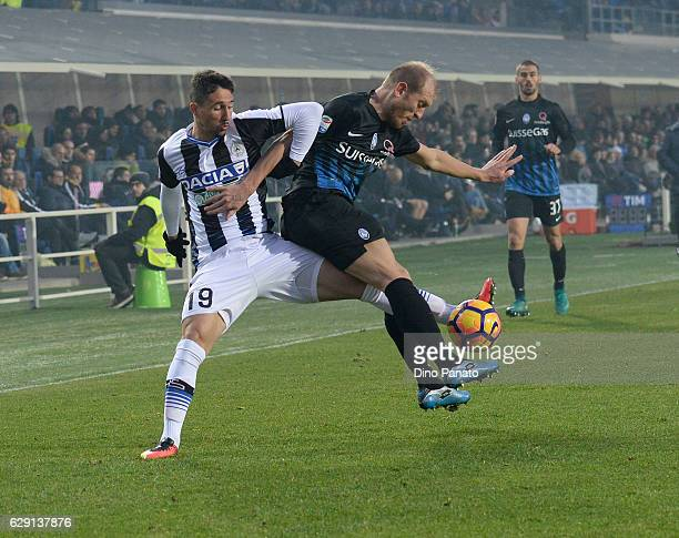 Andrea Masiello of Atalanta BC competes with Santos Ryder Matos of Udinese Calcio during the Serie A match between Atalanta BC and Udinese Calcio at...