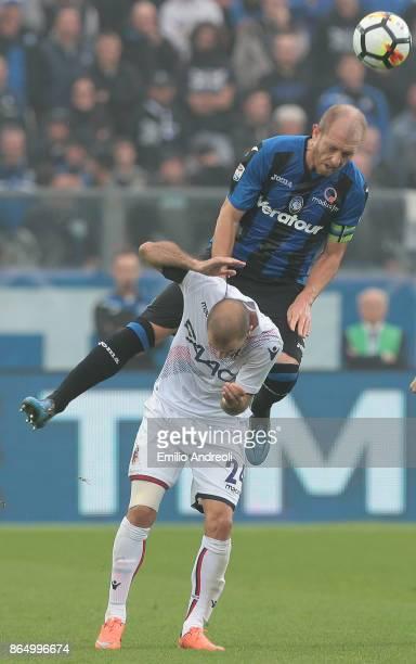 Andrea Masiello of Atalanta BC jumps for the ball with Rodrigo Palacio of Bologna FC during the Serie A match between Atalanta BC and Bologna FC at...