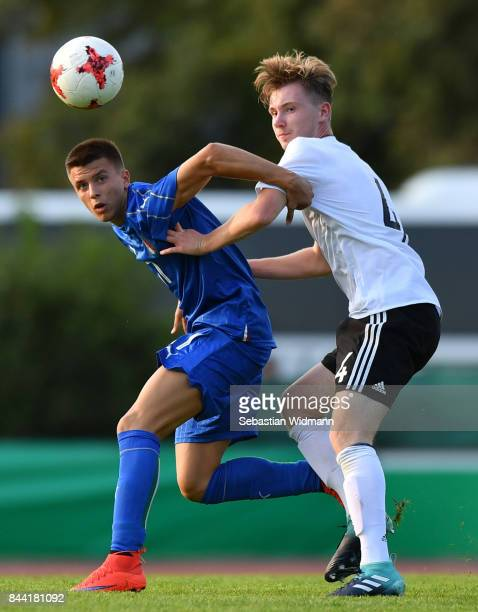 Andrea Mattioli of Italy and Niclas Knoop of Germany compete for the ball during the Four Nations Tournament match between U17 Germany and U17 Italy...