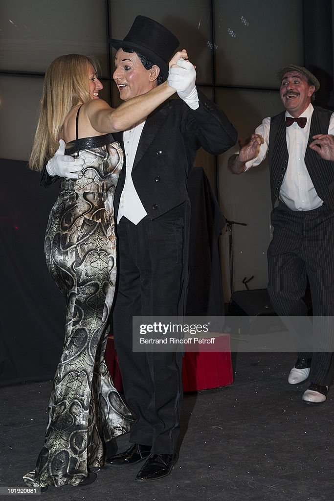 Andrea Mayer (L) dances with a member of comic duet 'The Rolling Dominos' during the 30th edition of 'La Nuit Des Neiges' Charity Gala on February 16, 2013 in Crans-Montana, Switzerland.