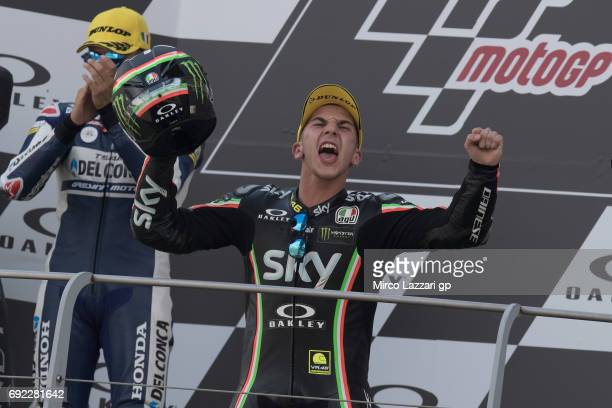 Andrea Migno of Italy and Sky Racing Team VR46 celebrates the victory on the podium at the end of the Moto3 race during the MotoGp of Italy Race at...