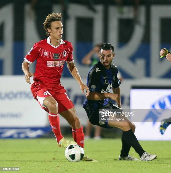 Andrea Milani of Latina competes for the ball with Stefano Beltrame of Bari during the Serie B playoff match between US Latina and AS Bari at Stadio...