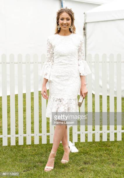 Andrea Moore wearing Stephanie Browne headpiece and Collezione Santina dress at TAB Everest Day at Royal Randwick Racecourse on October 14 2017 in...