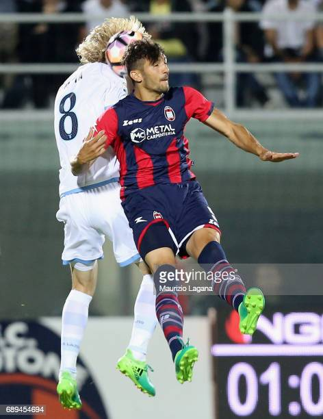 Andrea Nalini of Crotone competes for the ball in air with Dusan Basta of Lazio during the Serie A match between FC Crotone and SS Lazio at Stadio...