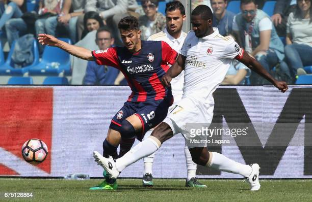 Andrea Nalini of Crotone competes for the ball with Chistian Zapata of Milan during the Serie A match between FC Crotone and AC Milan at Stadio...