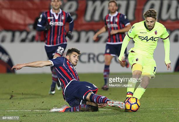 Andrea Nalini of Crotone competes for the ball with Federico Di Francesco of Bologna during the Serie A match between FC Crotone and Bologna FC at...