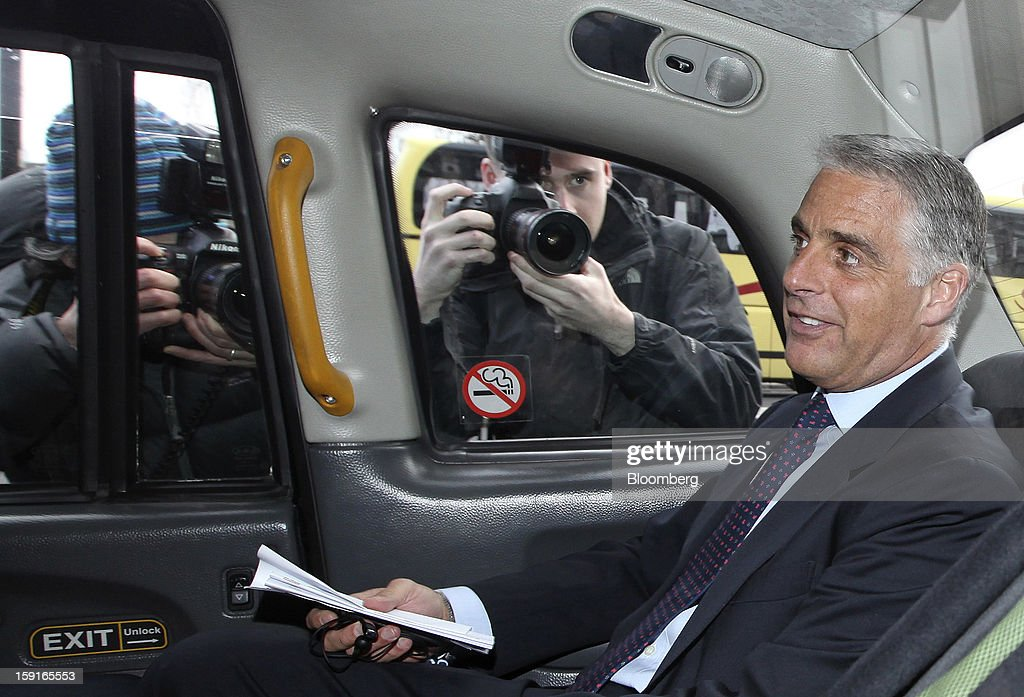 Andrea Orcel, chief executive officer of investment banking at UBS AG, right, leaves Portcullis House by taxi after giving evidence to the U.K. Parliament's Banking Standards Committee hearing on Libor in London, U.K., on Wednesday, Jan. 9, 2013. 'We all got probably too arrogant, too self-convinced the things were correct the way they were -- I think the industry has to change,' Orcel, 49, said at a parliamentary hearing on Libor in London today. Photographer: Chris Ratcliffe/Bloomberg via Getty Images