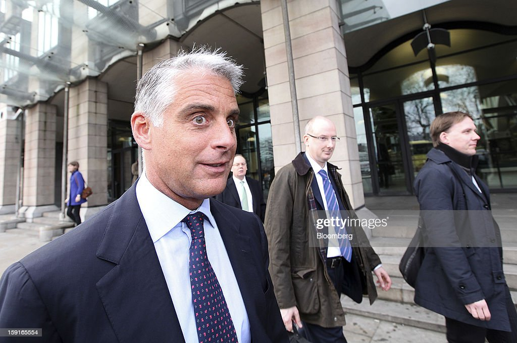 Andrea Orcel, chief executive officer of investment banking at UBS AG, left, and Andrew Williams, global head of compliance at UBS AG, center, leave Portcullis House after giving evidence to the U.K. Parliament's Banking Standards Committee hearing on Libor in London, U.K., on Wednesday, Jan. 9, 2013. 'We all got probably too arrogant, too self-convinced the things were correct the way they were -- I think the industry has to change,' Orcel, 49, said at a parliamentary hearing on Libor in London today. Photographer: Chris Ratcliffe/Bloomberg via Getty Images
