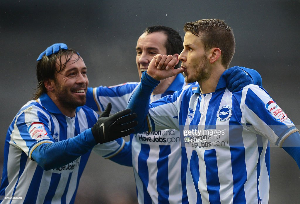Andrea Orlandi of Brighton (R) celebrates after scoring with team mates Inigo Calderon (L) and David Lopez during the npower Championship match between Brighton & Hove Albion and Derby County at Amex Stadium on January 12, 2013 in Brighton, England.
