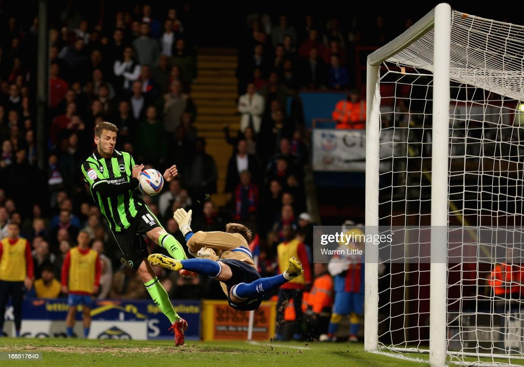 Andrea Orlandi of Brighton & Hove Albion hands the ball as Keeper Tomasz Kuszczak dives during the npower Championship play off semi final first leg at Selhurst Park on May 10, 2013 in London, England.