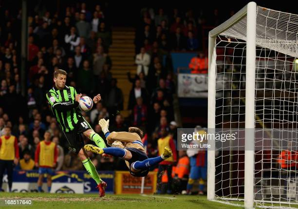 Andrea Orlandi of Brighton Hove Albion hands the ball as Keeper Tomasz Kuszczak dives during the npower Championship play off semi final first leg at...