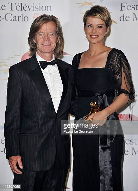Andrea Osvart poses with her Golden Nymphe award next to William H Macy after the closing ceremony of the 2011 Monte Carlo Television Festival held...