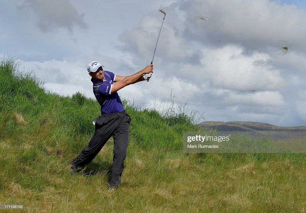 Andrea Pavan of Italy plays his approach shot to the 17th from an awkward lie during the Third Round of the Scottish Hydro Challenge hosted by MacDonald Hotels & Resorts on June 22, 2013 in Aviemore, Scotland.