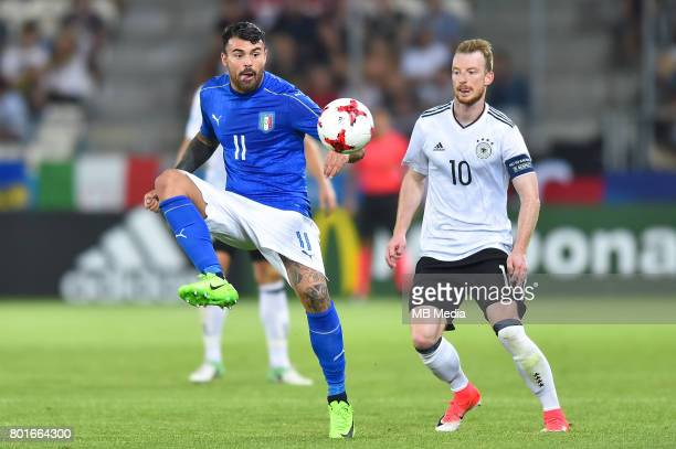 Andrea Petagna Maximilian Arnold during the UEFA European Under21 match between Italy and Germany on June 24 2017 in Krakow Poland