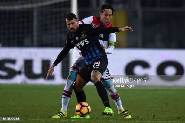 Andrea Petagna of Atalanta and Claiton dos Santos of Crotone compete for the ball during the Serie A match between Atalanta BC and FC Crotone at...