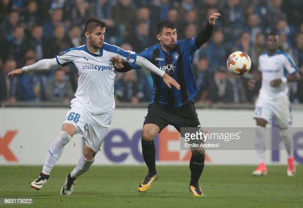 Andrea Petagna of Atalanta BC competes for the ball with Andrei Pitian of Apollon Limassol FC during the UEFA Europa League group E match between...