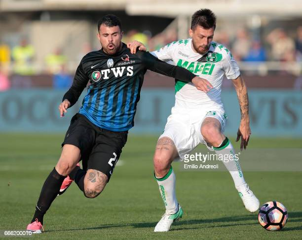 Andrea Petagna of Atalanta BC competes for the ball with Francesco Acerbi of US Sassuolo Calcio during the Serie A match between Atalanta BC and US...
