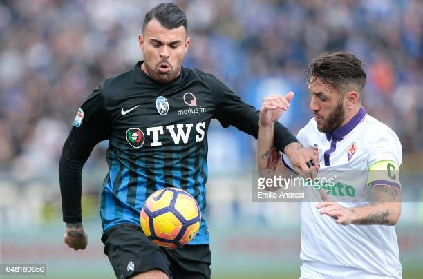 Andrea Petagna of Atalanta BC competes for the ball with Gonzalo Rodriguez of ACF Fiorentina during the Serie A match between Atalanta BC and ACF...