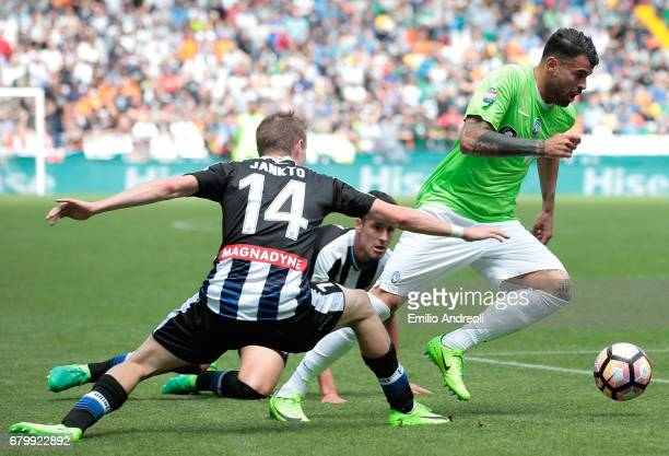 Andrea Petagna of Atalanta BC competes for the ball with Jakub Jankto of Udinese Calcio during the Serie A match between Udinese Calcio and Atalanta...
