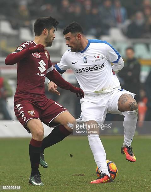Andrea Petagna of Atalanta BC competes for the ball with Marco Benassi of Torino FC during the Serie A match betweenFC Torino and Atalanta BC at...