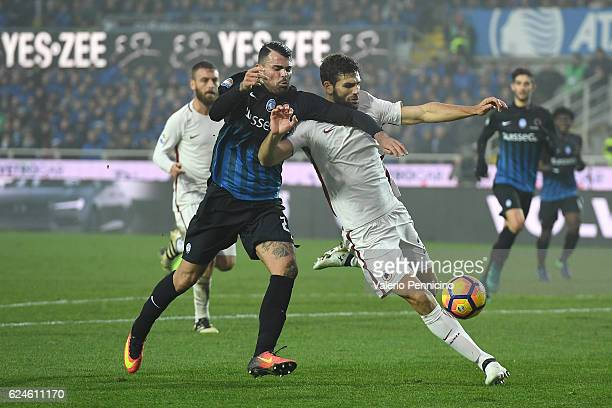 Andrea Petagna of Atalanta BC competes with Federico Fazio of AS Roma during the Serie A match between Atalanta BC and AS Roma at Stadio Atleti...