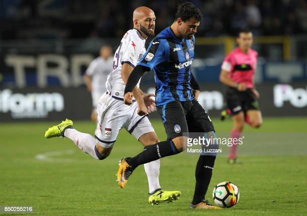 Andrea Petagna of Atalanta BC is challenged by Arlind Ajeti of FC Crotone during the Serie A match between Atalanta BC and FC Crotone at Stadio...