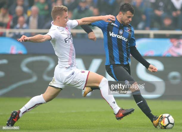 Andrea Petagna of Atalanta BC is challenged by Emil Krafth of Bologna FC during the Serie A match between Atalanta BC and Bologna FC at Stadio Atleti...