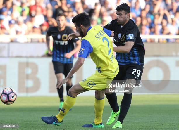Andrea Petagna of Atalanta BC is challenged by Federico Nicolas Spolli of AC Chievo Verona during the Serie A match between Atalanta BC and AC Chievo...