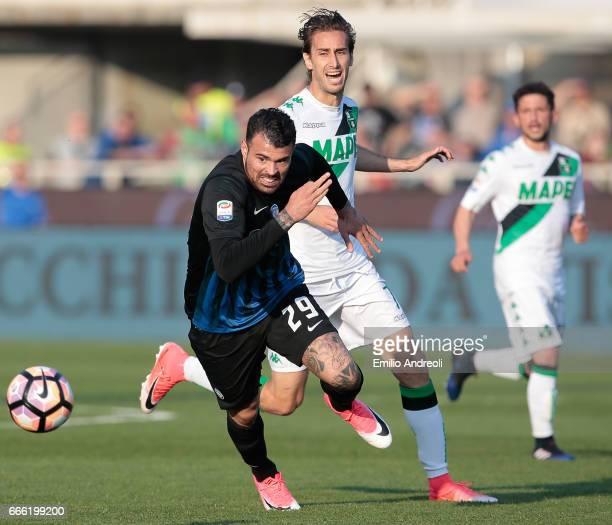 Andrea Petagna of Atalanta BC is challenged by Simone Missiroli of US Sassuolo Calcio during the Serie A match between Atalanta BC and US Sassuolo at...