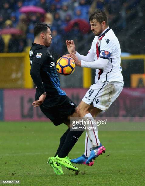 Andrea Petagna of Atalanta competes for the ball with Daniele Dessena of Cagliari during the Serie A match between Atalanta BC and Cagliari Calcio at...